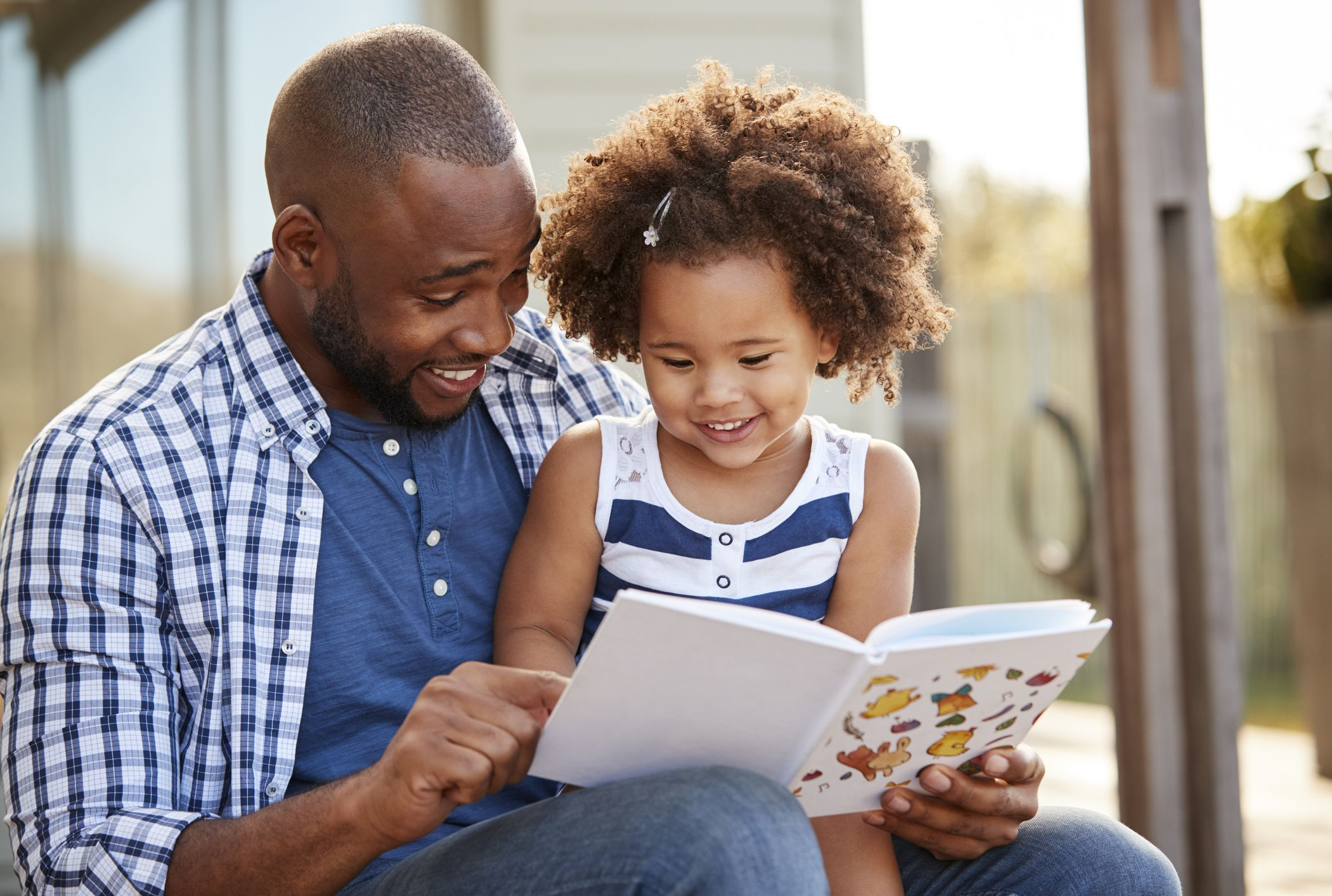 Why Readingmate App Exists Blog Post - image of a black father reading to his daughter