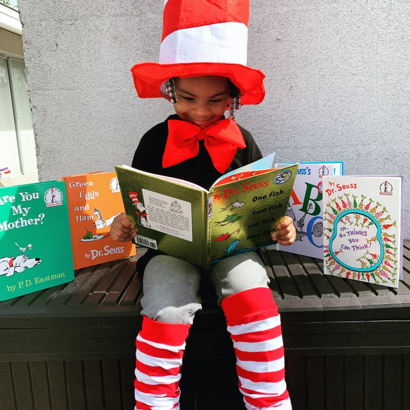 child on world book day wearing a cat in the hat costume -fear of reading how to help
